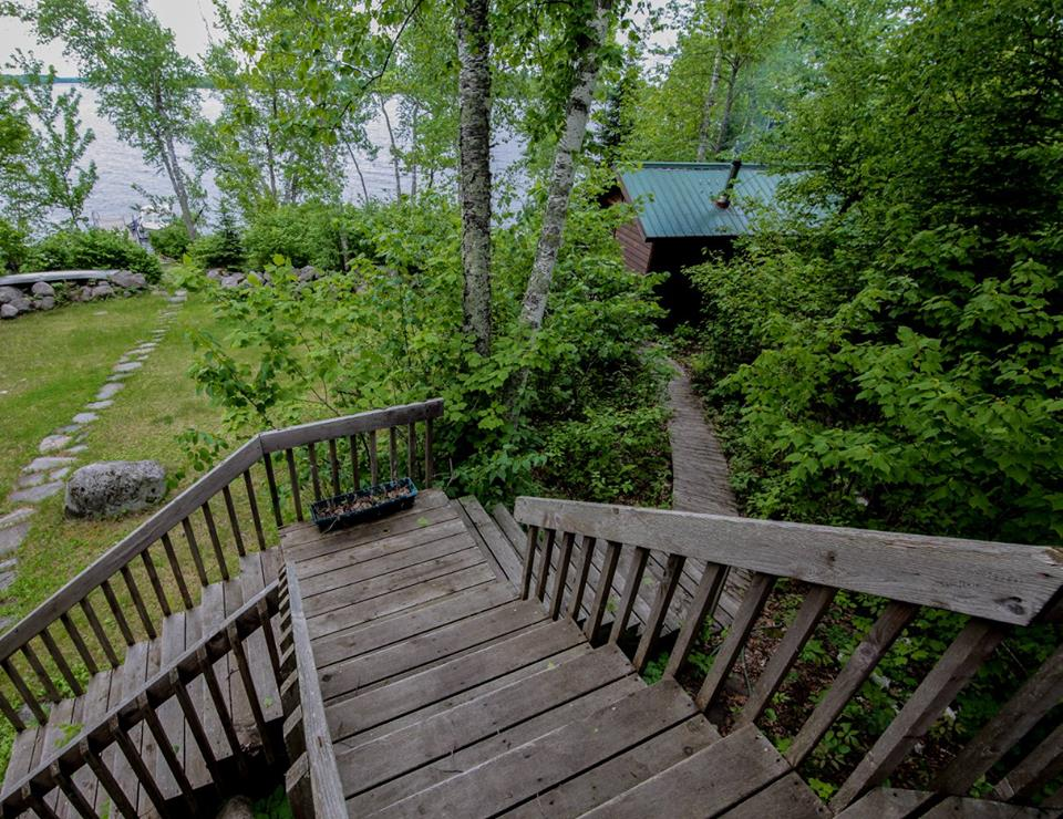 Sauna building as viewed from steps of cabin (photo: Garrett Conover)