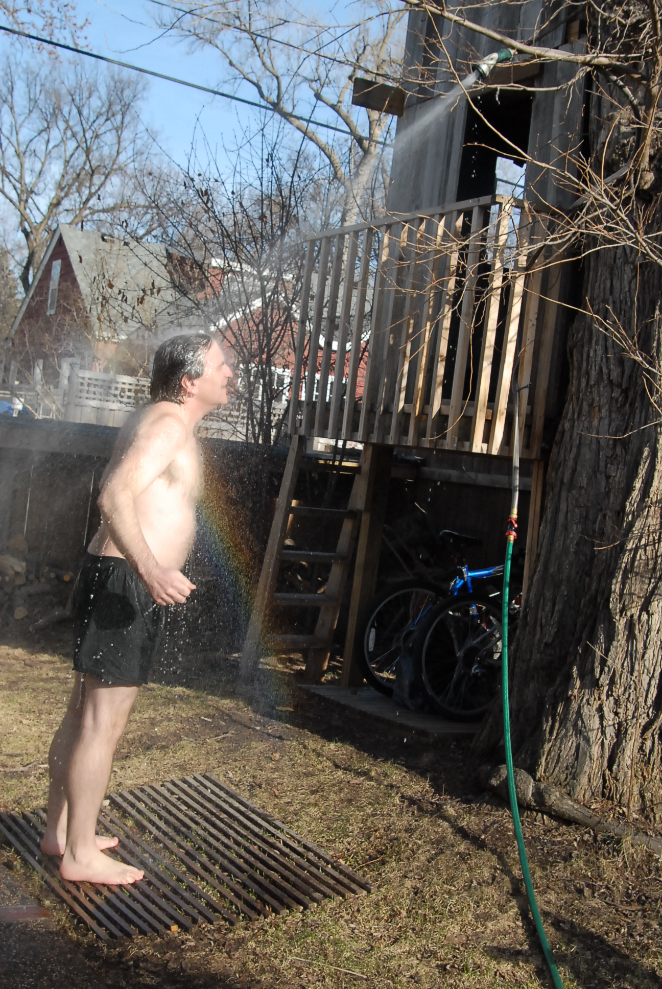 Outdoor shower hose hookup