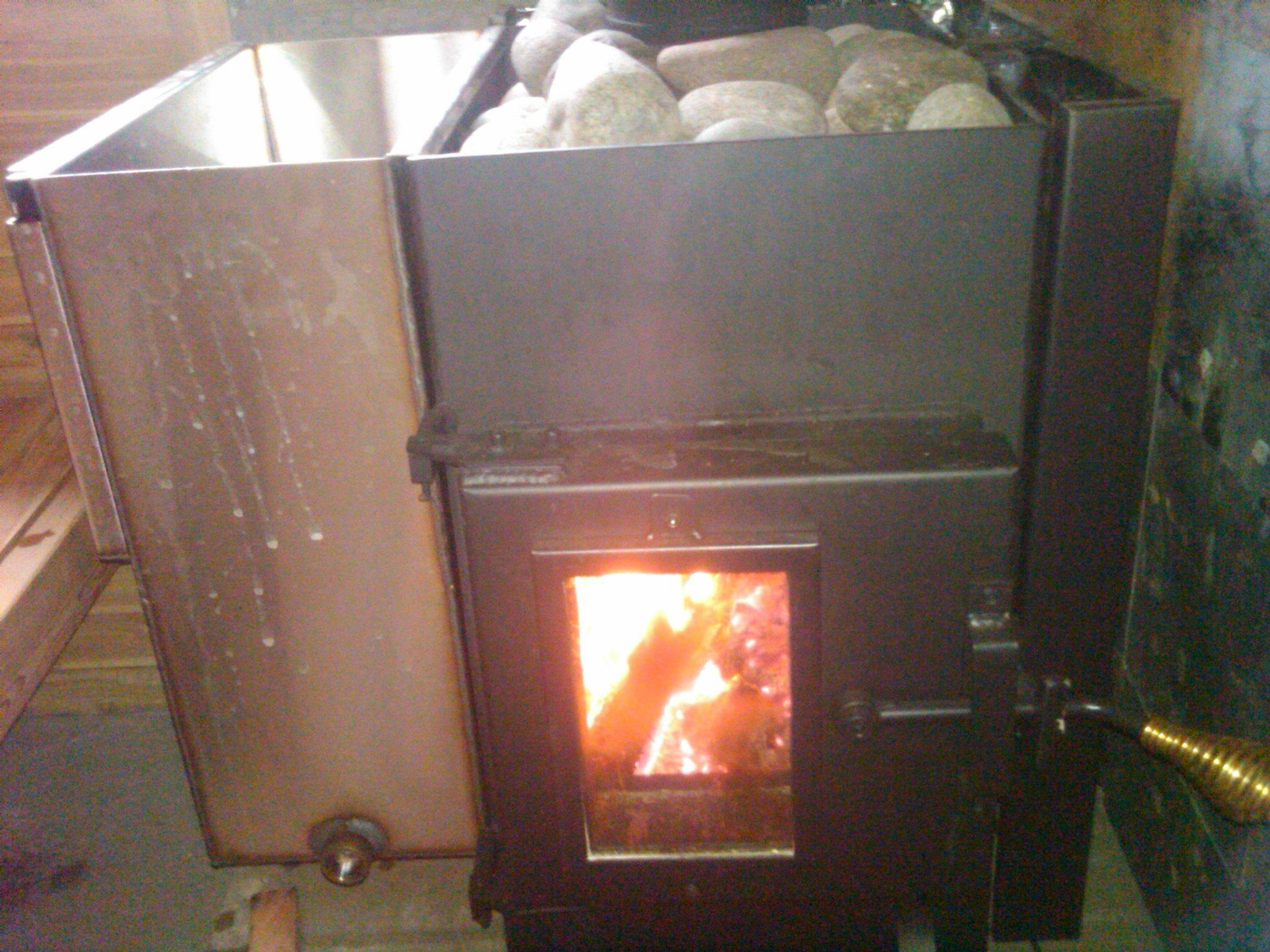 Should i get a wood fired sauna stove or an electric sauna for Build a wood burning sauna