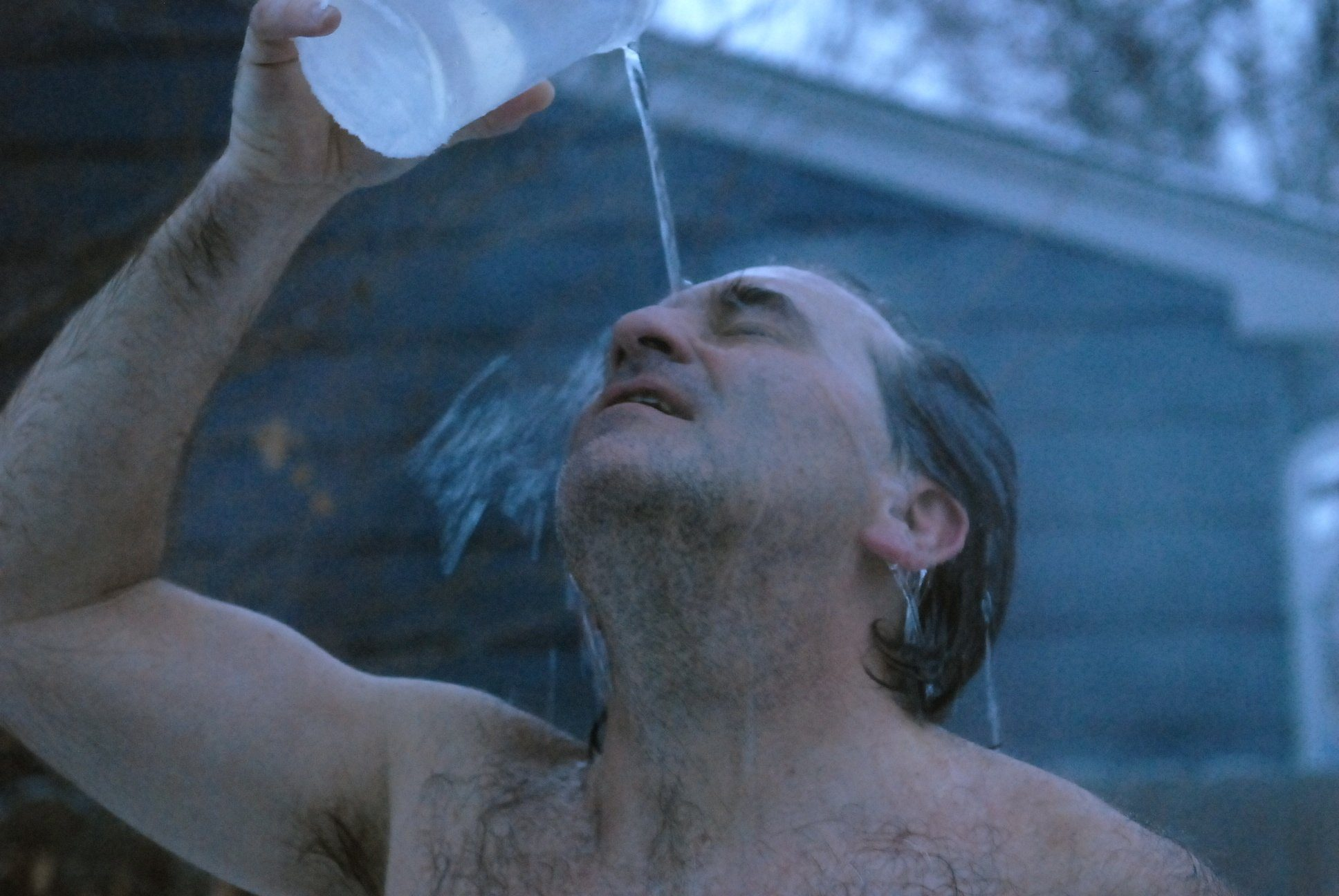 pouring-water-on-yourself-after-a-sauna