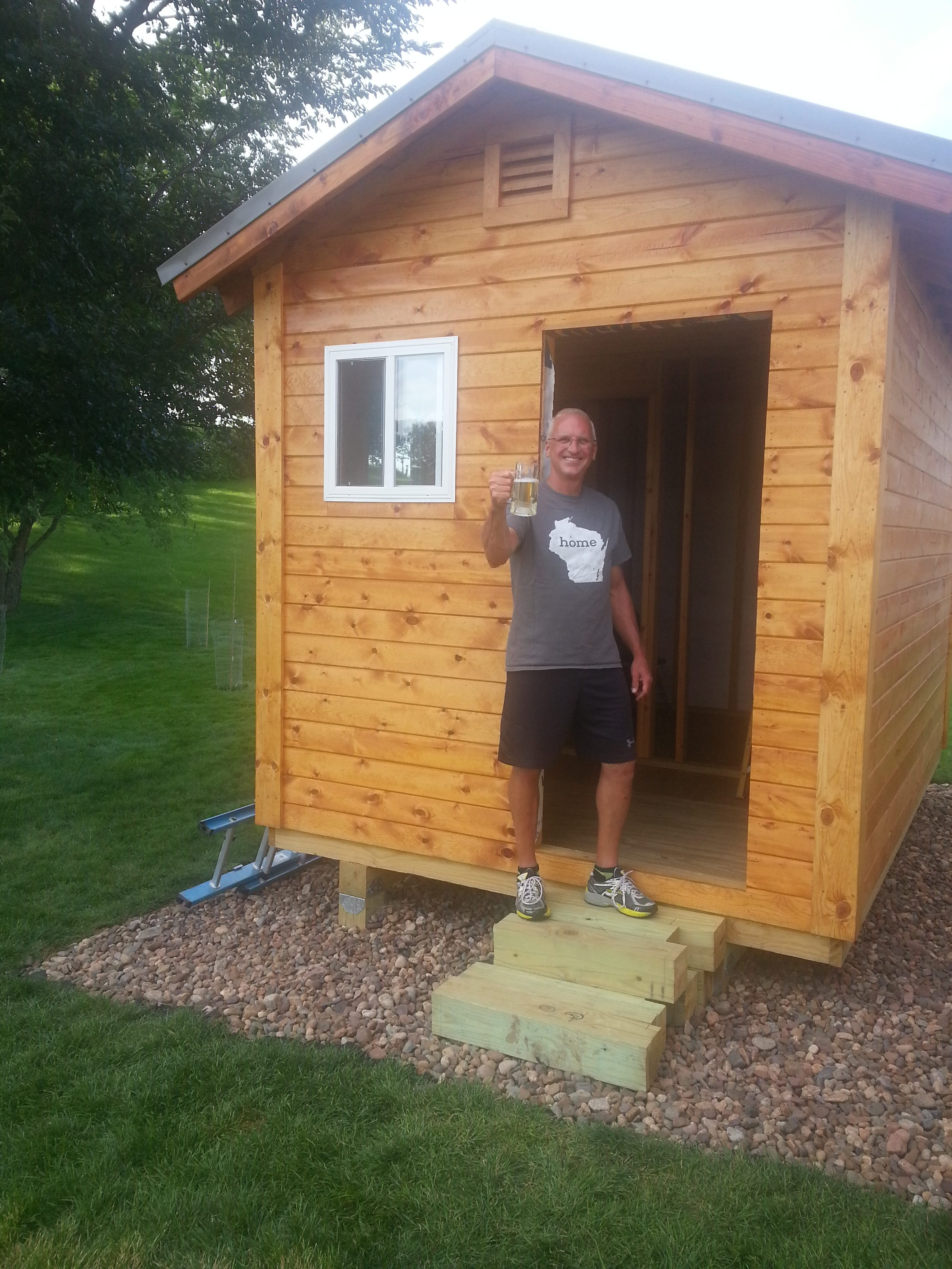 Backyard Sauna Plans enjoying the sauna building journey with a cold one in hand - saunatimes