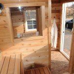A lively open hot room: sauna door, candle window and all cedar tongue and groove.