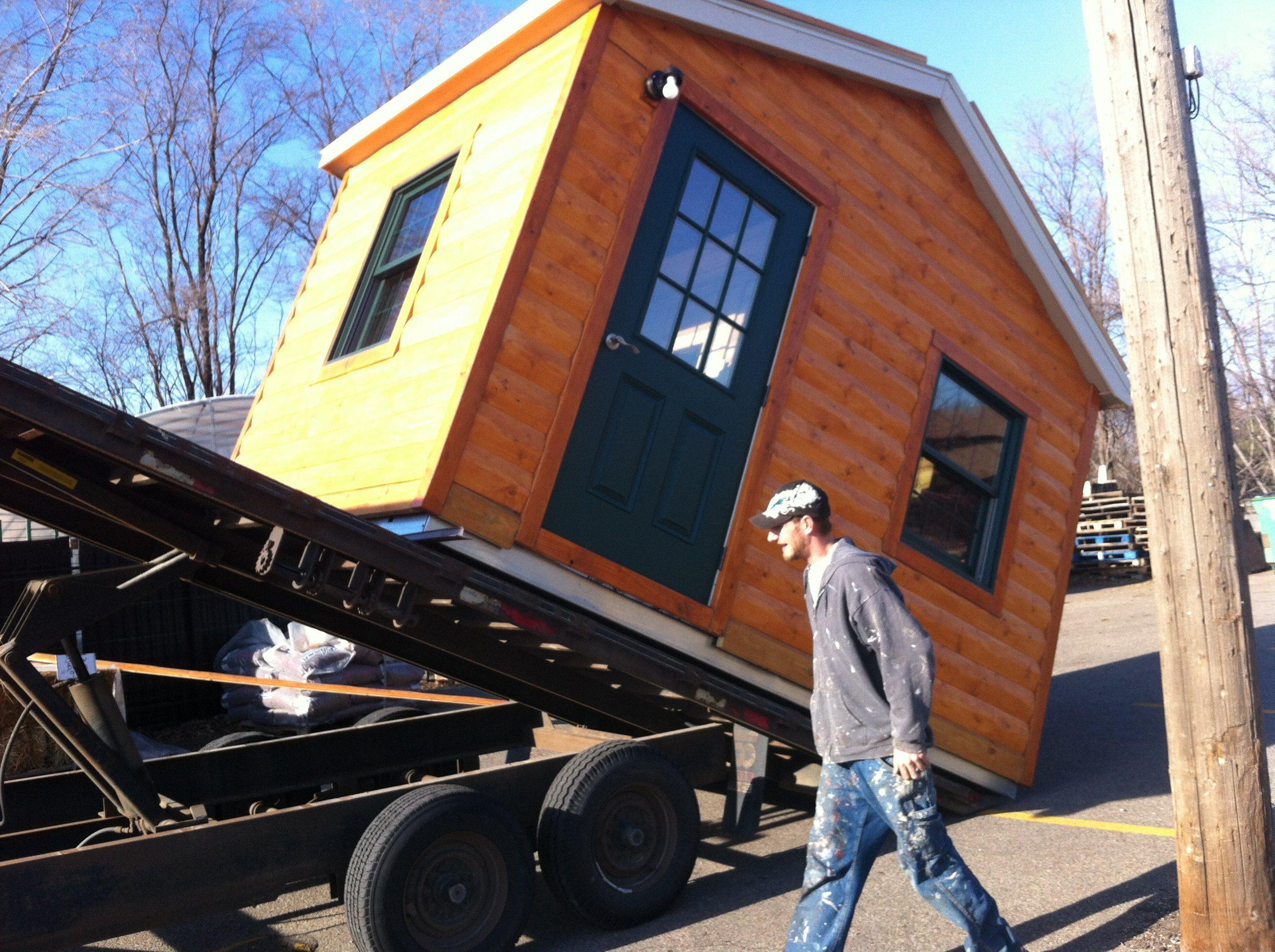 loading sauna on flatbed trailer.