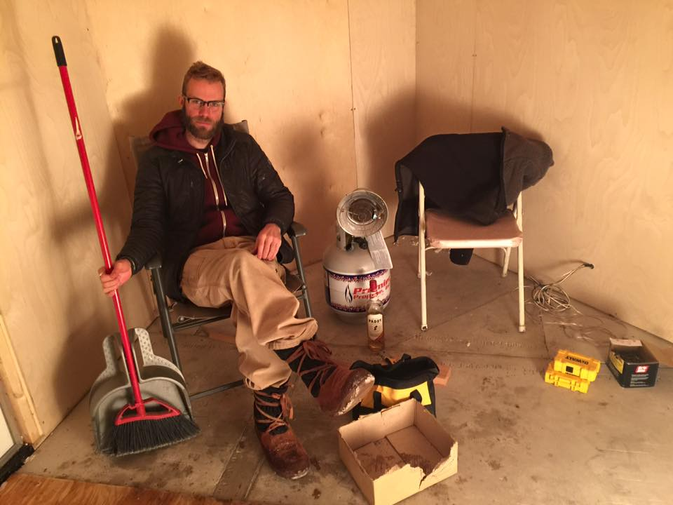 JP contemplating consensus in 612 Mobile Sauna changing room.