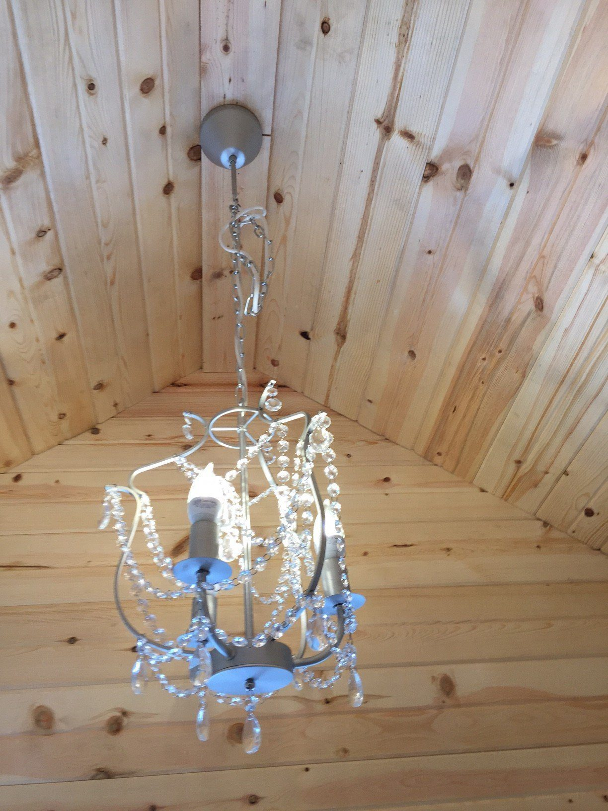 Rich sauna view of chandelier