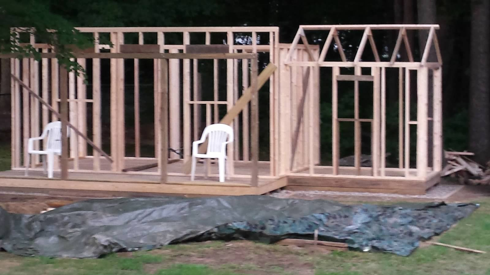 Sauna building framed in. Note chairs to help sauna builder feel the vibe of finished space.