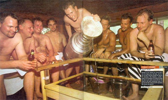 Former NHL player and Stanley Cup winner Ville Nieminen using the Stanley Cup to toss water on the sauna rocks.  September 5, 2001, then with the Colorado Avalanche.