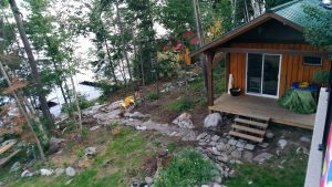 A wood burning sauna gets nestled into the hillside on a boat access property in Northern Ontario