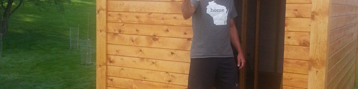 Sauna builder Gary, winning The War of Art with a beer in hand.