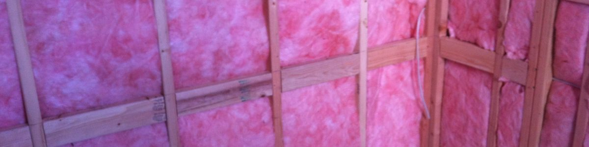 a sauna hot room, with blocking for sauna benches, almost ready for tongue and groove paneling (needs foil vapor barrier)