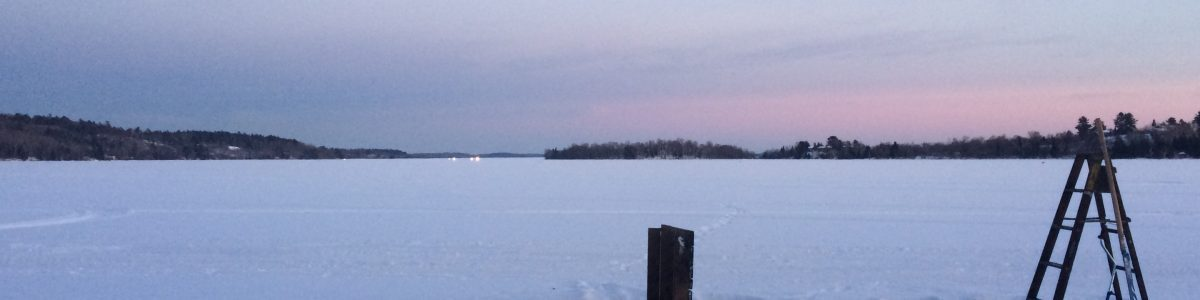 a hole in the ice as the moon rises on lake vermilion