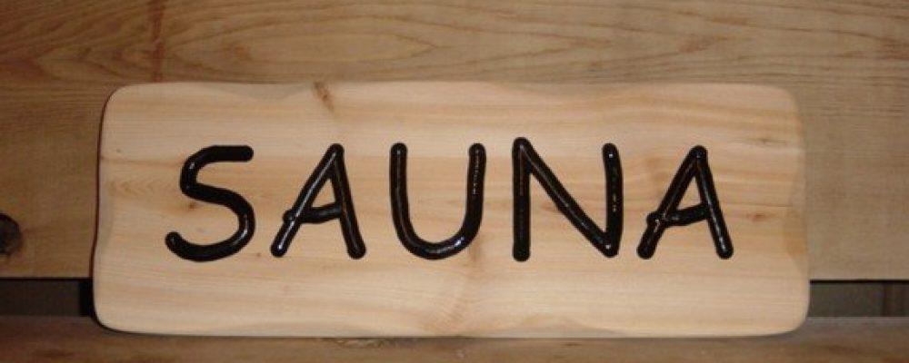 hand routed cedar sauna sign