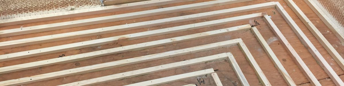 glue and screw sleepers at decreasing widths to drain