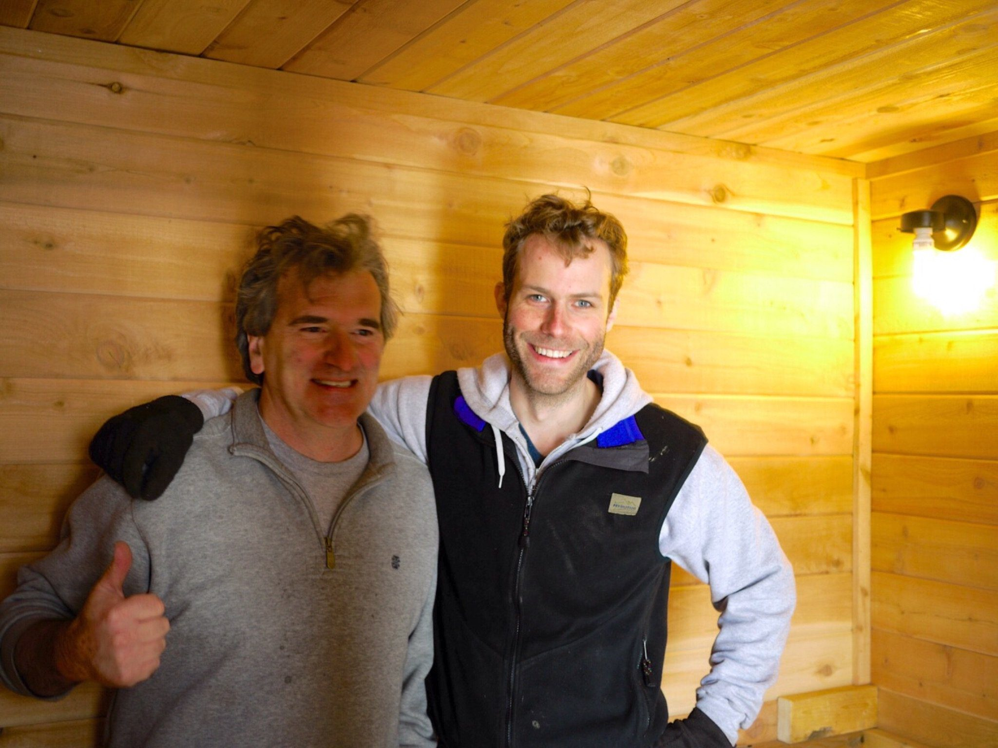 Saunatimes founder Glenn (left) and 612 Sauna Society founder JP (right) discussing tongue and groove cedar whilst in hot room of mobile sauna