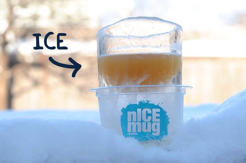 in snow with word ice. drinking glass made out of ice.  ice mug. beer glass.