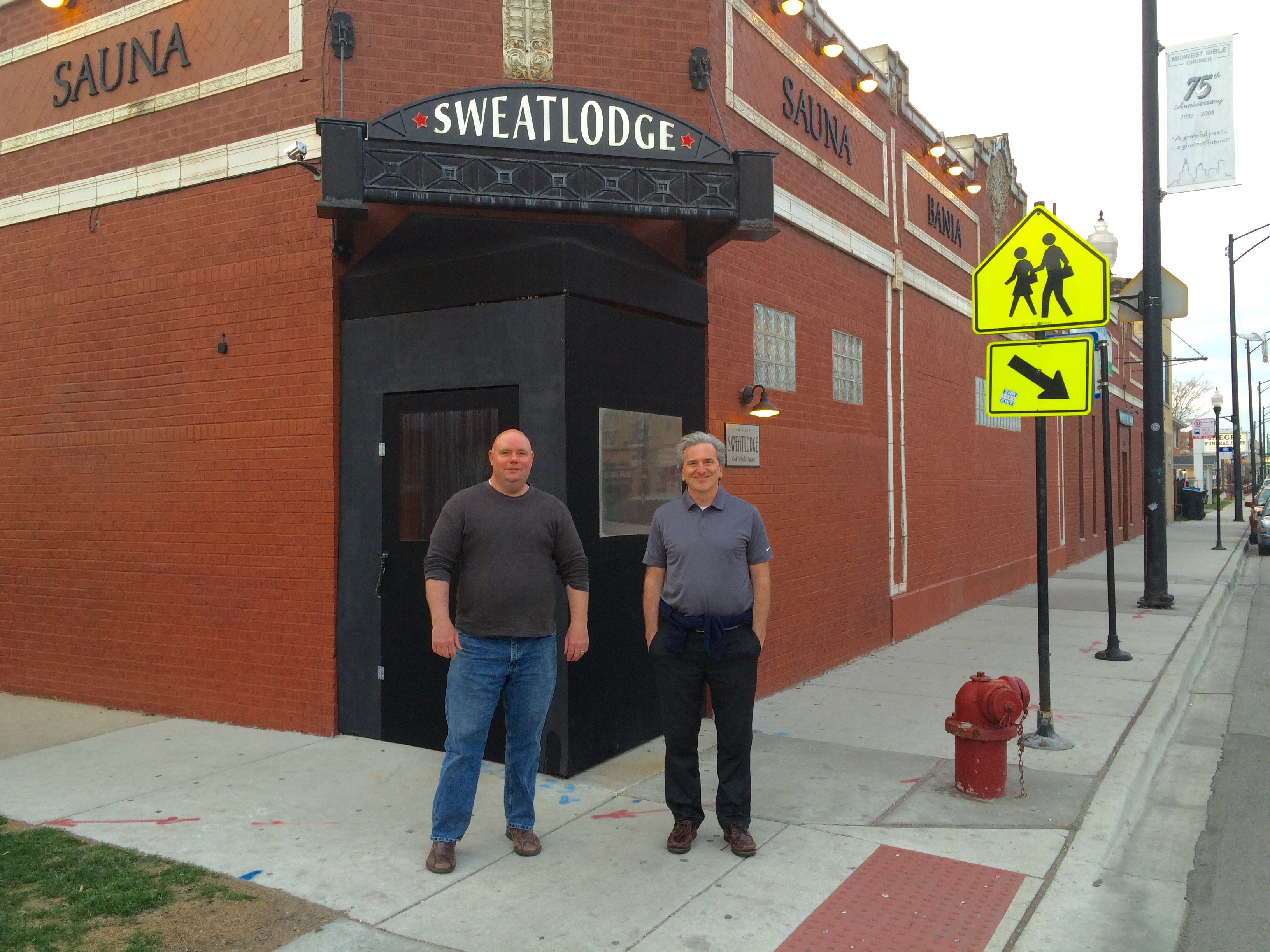 Outside Chicago Sweatlodge, Kevin (left) and Glenn check in with Bill Trotter, GM.