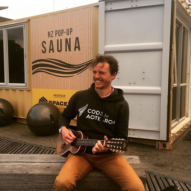 Pete Digging himself outside the NZ Pop-Up Sauna between sauna rounds by the Wellington harbour.