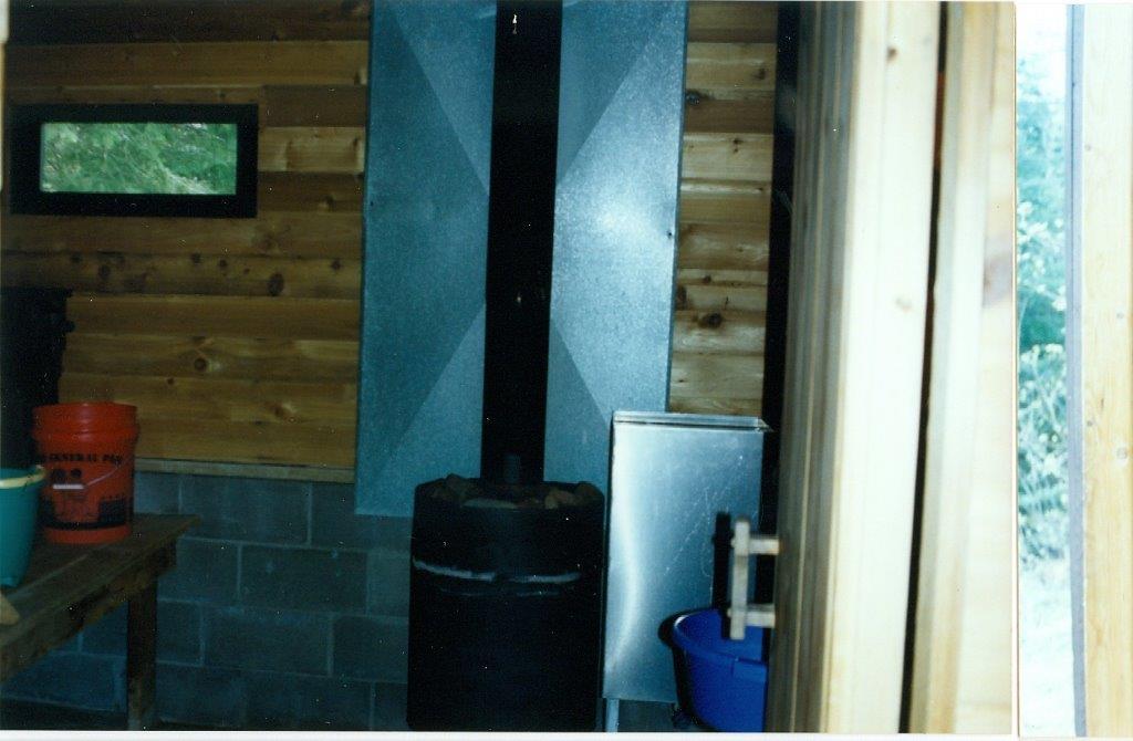 Tending to Vern's sauna stove