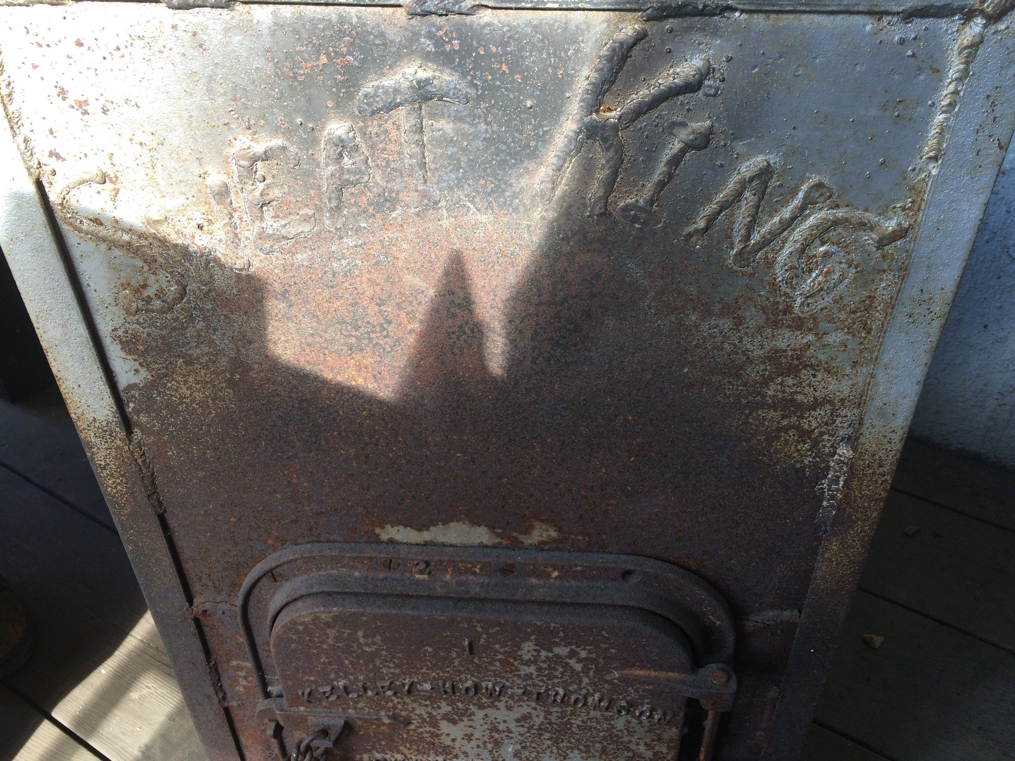 One of Daryl's Grandfather's original sauna stoves. The Sweat King. est. 1925.